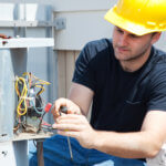 HVAC technician repairing HVAC unit