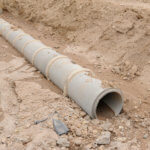 drain pipe in trench with slope