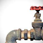 Old water valve on white light background