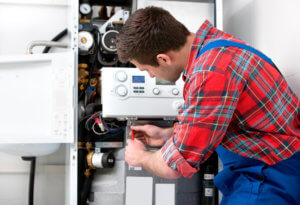 boiler repair man working on boiler system