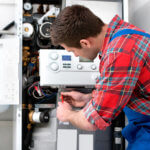 Technician servicing boiler