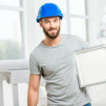 man holding HVAC filter
