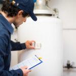 man testing hot water heater